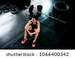 attractive fit woman concetrate ... | Shutterstock . vector #1066400342