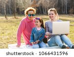 a small girl with mother and... | Shutterstock . vector #1066431596