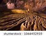 Small photo of Man exploring beautiful cave at Nguom ngao cave near Ban Gioc waterfalls , Cao bang - North of Vietnam.