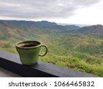 green cup of hot americano... | Shutterstock . vector #1066465832