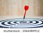 red dart arrow hit the center... | Shutterstock . vector #1066484912
