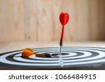 winner red dart arrow hit the... | Shutterstock . vector #1066484915