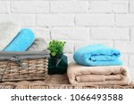 clean towels near brick wall in ... | Shutterstock . vector #1066493588