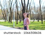 Young Woman Strolling In Park ...