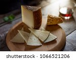cured cheese on board | Shutterstock . vector #1066521206