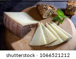 cured cheese on board | Shutterstock . vector #1066521212