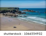 surfers on a beach in cornwall... | Shutterstock . vector #1066554932
