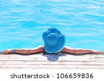 Woman In Hat Relaxing At...