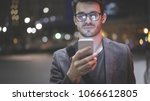 a smiling man wearing... | Shutterstock . vector #1066612805