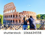 young couple at colosseum in... | Shutterstock . vector #1066634558