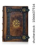 """Small photo of Leather bound book with gilded ancient Viking symbol - front view of the front cover. English translation of the symbol is: """"That Which Shows the Way"""""""