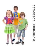 Back to school - kids holding large abc letters, isolated - stock photo