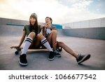 woman skateboarders laughing...   Shutterstock . vector #1066677542