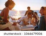 group of men and women having a ... | Shutterstock . vector #1066679006
