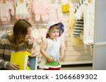 young mother and her daughter... | Shutterstock . vector #1066689302