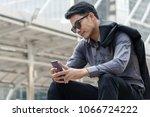 handsome young businessman... | Shutterstock . vector #1066724222