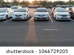 Stock photo cars parked in the parking lot parking lot with copy writing space 1066729205