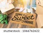 man and woman unpacking near... | Shutterstock . vector #1066762622