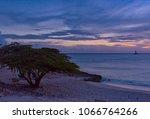 superb sunset on the caribbean... | Shutterstock . vector #1066764266