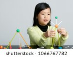 asian children play with straws.... | Shutterstock . vector #1066767782