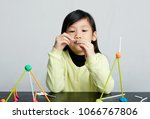 asian children play with straws.... | Shutterstock . vector #1066767806
