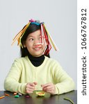 asian children play with straws.... | Shutterstock . vector #1066767812