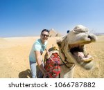 selfie with camel smiling at... | Shutterstock . vector #1066787882