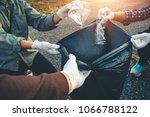 women volunteer help garbage... | Shutterstock . vector #1066788122