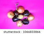 Small photo of Fruit-shaped face shape isolated on pink background