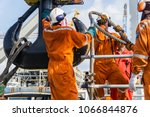 offshore workers installing big ... | Shutterstock . vector #1066844876