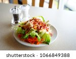 salad and crispy bacon in white ... | Shutterstock . vector #1066849388