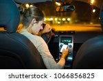 pretty young woman driving her... | Shutterstock . vector #1066856825