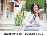 smiling woman using mobile... | Shutterstock . vector #1066858106
