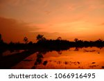 sunset with orange shad golden... | Shutterstock . vector #1066916495