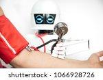 medical assistance robot is... | Shutterstock . vector #1066928726
