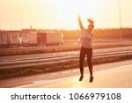 image of a young sportswoman... | Shutterstock . vector #1066979108