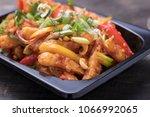 crispy chilli potatao | Shutterstock . vector #1066992065