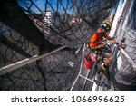 rope access worker abseiling... | Shutterstock . vector #1066996625