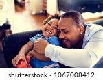 happy african descent family | Shutterstock . vector #1067008412