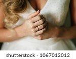 hands of the bride | Shutterstock . vector #1067012012