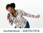 black passionate woman vocalist ... | Shutterstock . vector #1067017076