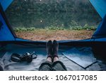 people camping by the river | Shutterstock . vector #1067017085