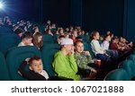 sideview of boys watching movie ... | Shutterstock . vector #1067021888