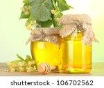 jars with linden honey and... | Shutterstock . vector #106702562
