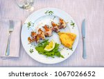 fried squids on skewer with...   Shutterstock . vector #1067026652