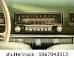 Stock photo retro styled image of an old car radio inside a green classic car 1067043515