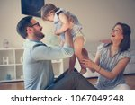 happy family with one child.  | Shutterstock . vector #1067049248