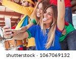 two happy beautiful blonde girl ... | Shutterstock . vector #1067069132