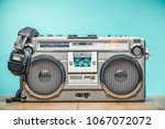 retro outdated portable stereo... | Shutterstock . vector #1067072072