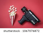 flat lay of cone with popcorn... | Shutterstock . vector #1067076872